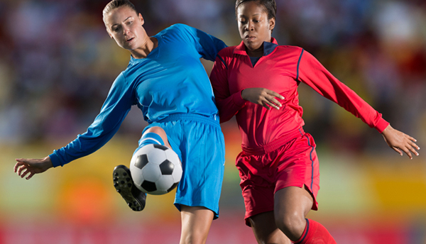 Female soccer players in action during a match. Composite image.